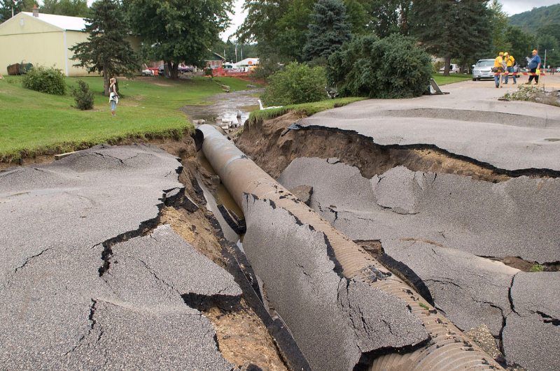 A collapsed road in Minnesota caused by a flood. PC: Harvard Political Review, http://harvardpolitics.com/united-states/drip-drop-americas-crumbling-water-infrastructure/